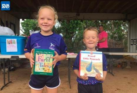 Rugby players donate books to charity